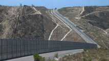 A photograph of a border fence