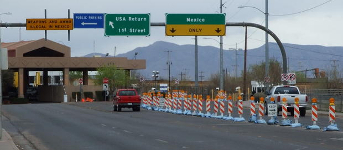 A vehicle checkpoint at a border crossing