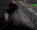 A thermal image of the fence-line with a person highlighted next to the fence